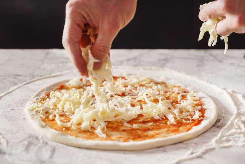 Adding Cheese to Homemade Pizza