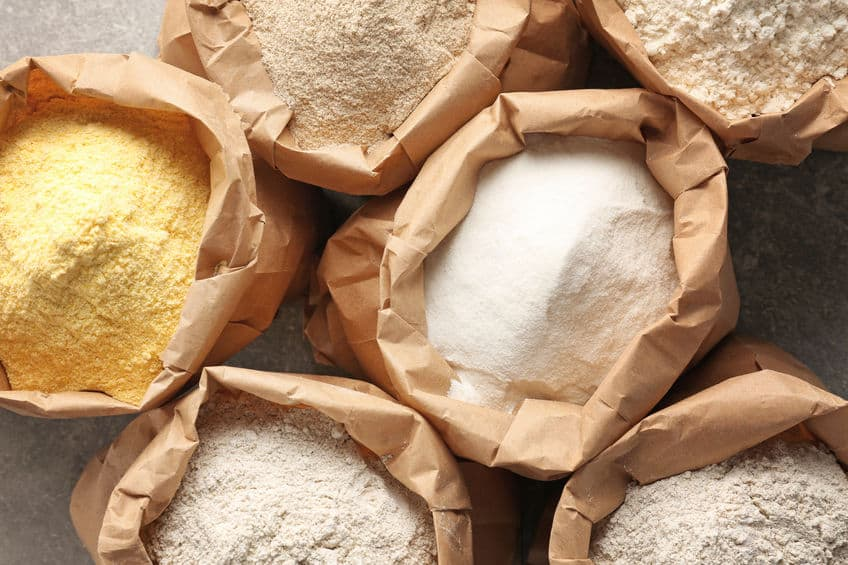 different flours in paper bags image